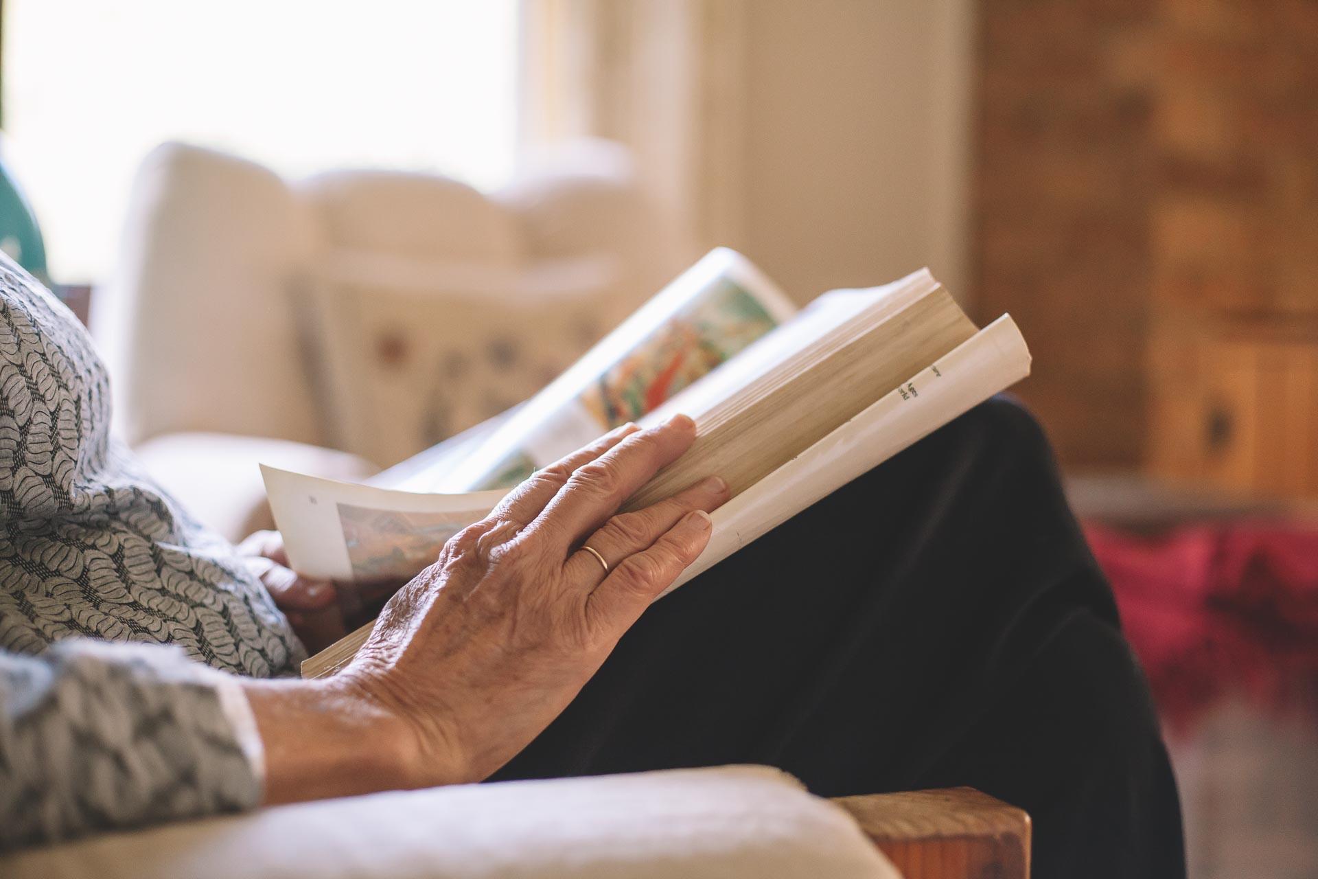 retiree reading book on lounge
